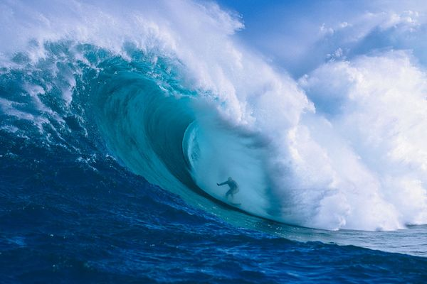 Garrett McNamara in a huge barrel at Peahi, Maui. Photo: Ron Dahlquist