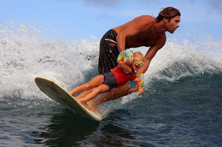 Sion Milosky surfs with his daughter.