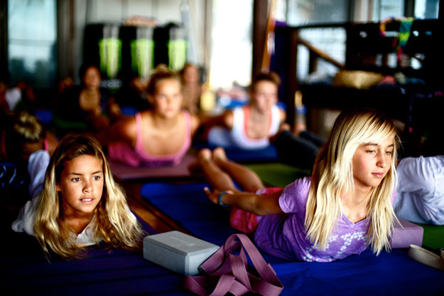 Rochelle leads a yoga class for young Billabong surfers at Off The Wall. Photo: Billabong