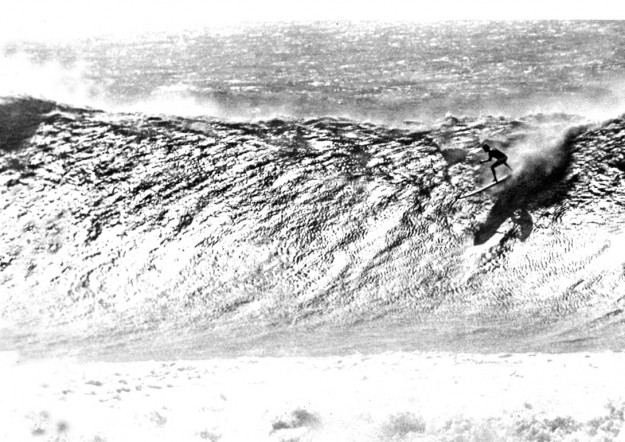 Greg Noll's legendary big wave at Makaha as captured by Alby Falzon