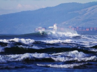 A tanker ship passes by a surfer at Ocean Beach. Photo: Seth Migdail/SFGate.com