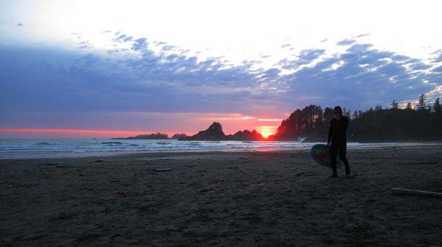 Surfer Walking Sunset Cox Bay Tofino Vancouver Island