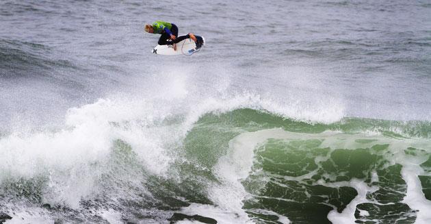 Ace Adrian Buchan surfs France