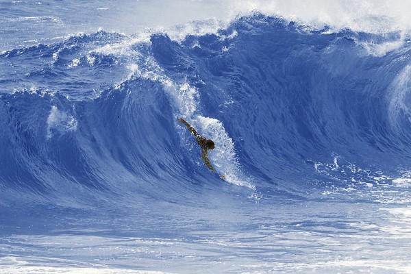 Bodysurfing is no joke. The author, Kenji Croman, getting it done.