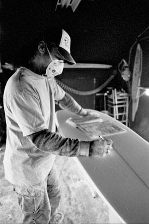 """After a few hours, my surfboard was done.  I shook his dust covered hand and told him I thought it was great that he was able to create something so pretty for a living. He looked at me, his voice muffled though his dust mask, his eyes smiling above it. """"I'm really lucky to do it because that's all I want to do, you know?"""" Photo: Emma Palm"""