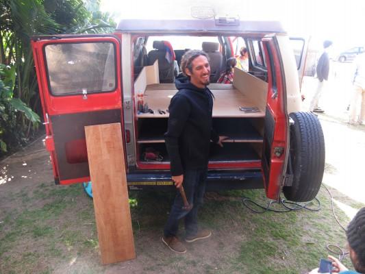 Rob Machado working on his ultimate surf van.
