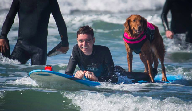 Caleb and Ricochet enjoying some rollers in San Diego. Photo: Dale Porter   Facebook: Surf Dog Ricochet