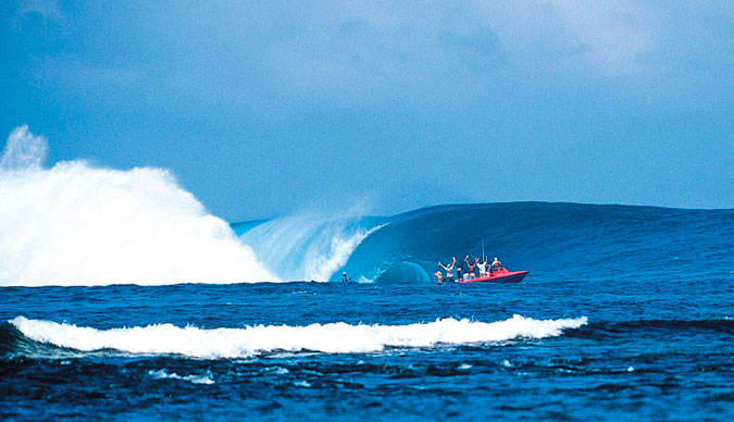 The Millenium Wave. It's clear from the reaction on the boat that something major is happening. Photo: Sean Davey