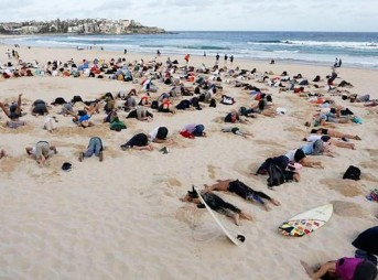 Many believe that Tony Abbott has his head in the sand when it comes to climate change. Photo: Mic.com