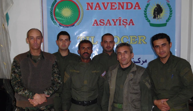 Parker, left, pictured with the Kurdish forces. Photo: Facebook