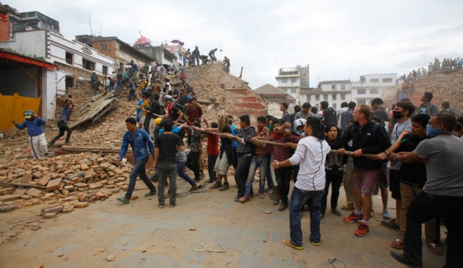 Volunteers removing debris at Durbar Square in Kathmandu. Photo: Niranjan Shrestha via AP