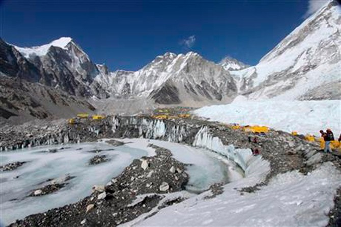 According to Ang Tshering of the Nepal Mountaineering Association, an avalanche triggered by a massive earthquake in Nepal smashed into a base camp between the Khumbu Icefall (pictured above this past April 11, 2015), a notoriously treacherous rugged area of collapsed ice and snow, and the base camp where most climbing expeditions are. Photo: Tashi Sherpa via AP