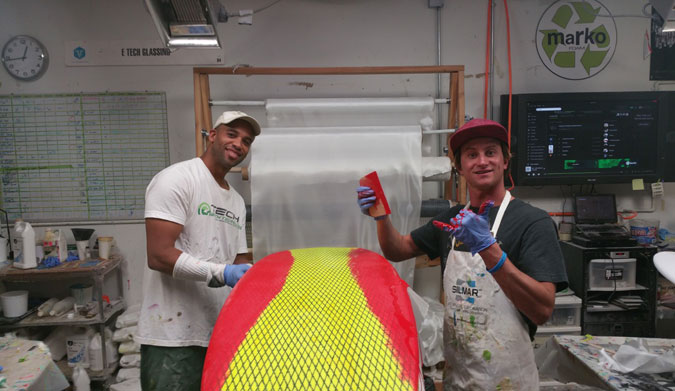Alex Gray glassing his own ecoboard at E-Tech with Ryan Harris.