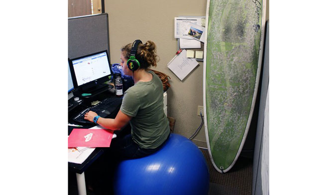 My first desk job - in the zone listening to music and balancing on my ball.