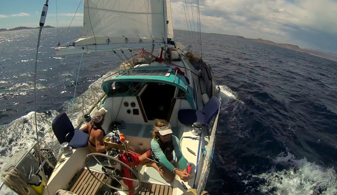 Energy and Research Group graduate student Jess Reilly and partner Josh Moman aboard their research sailboat, Oleada. Photo: Courtesy of Jess Reilly