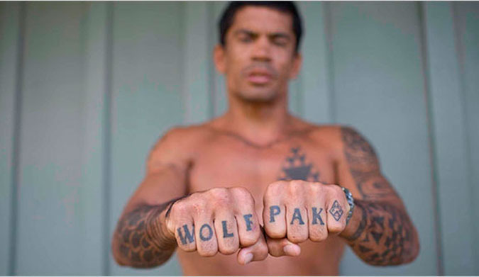 Kala's 'WOLF PAK' tattoo and his fists are processed by separate sets of brain regions depending on if you focus on the letters or his fingers.