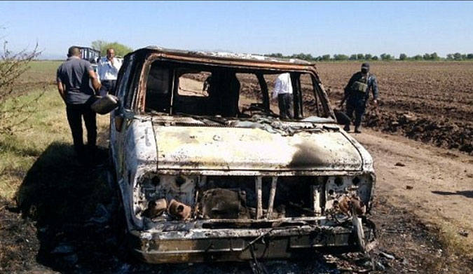 The bodies of two men were found in a burned van in Mexico.