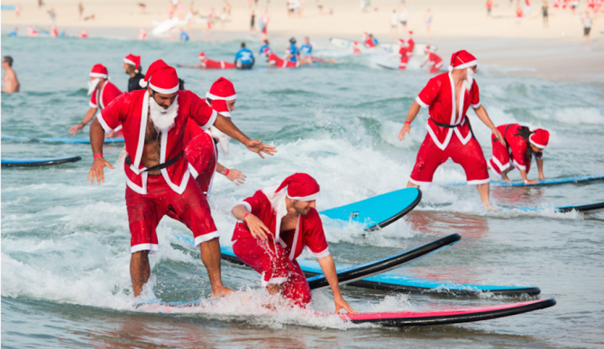 320 surfers flocked to Bondi Beach in Australia last week all clad in Santa Claus suits. The turnout was enough to beat the previous record for largest surf lesson, which was 250. Photo: Redballoon