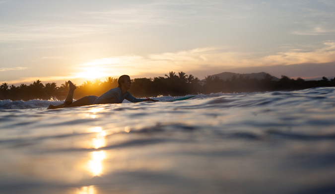 Sunrise session to start the day! With mountains and palm trees the view is not too shabby! Photo Courtesy of Two Feet and Classy
