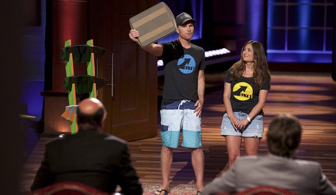 """SHARK TANK - """"Episode 710"""" - A man from Los Angeles has an innovative way to check your pet's health instantly with your phone, but an old-fashioned way to capture the specimen; an engaged couple from Monarch Beach, California have a lot riding on making a deal for their hand-held surfing boards; two men from Encinitas, California provide female consumers a stylish way to listen to music on fashionable headphones; and an entrepreneur from Mountain View, California has an idea that makes the most of the unused space on the backside of your cell phone. Also, Barbara Corcoran invites several entrepreneurs from businesses she's invested in to Cabo San Lucas to discuss topics ranging from opening up an online business to dealing with the """"overnight"""" success of being on the show, FRIDAY, APRIL 15 (9:00-10:01 p.m. EDT) on the ABC Television Network. (ABC/Tyler Golden) STEVE WATTS, ANGELA FERENDO (SLYDE HANDBOARDS)"""