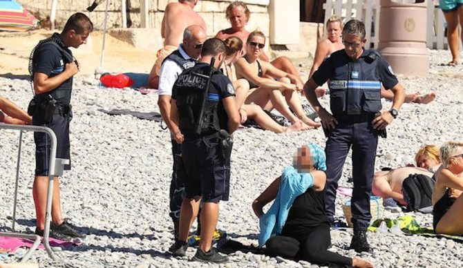French police asked a burkini clad sunbather to remove her clothes in Nice. Photo: The Guardian