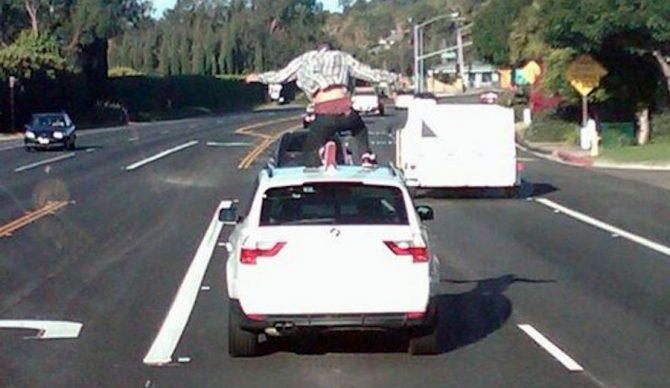 A Malibu teen car surfs in Los Angeles. Photo: LA County Sheriff's Department via AP
