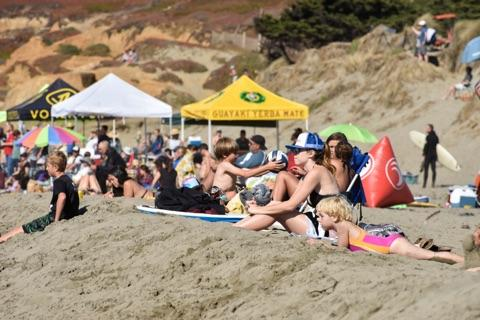 The beach was lined with sponsor tents and spectators.