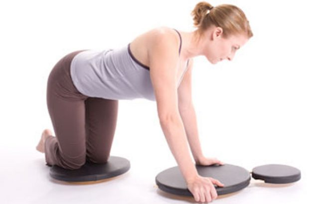 Popular for Pilates, rotator discs are a great option to build core strength at home. Photo: Little Bantam Trainer