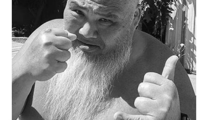 The two sides of Sumo: throwing punches to cancer, throwing shakas to everyone else. Photo: Cobian