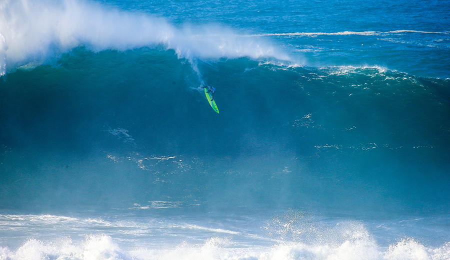 Jamie Mitchell flies down the face of a screamer at the 2016 Nazaré Challenge. The event is on Yellow Alert for a potential run on Friday. Photo: WSL / Laurent Masurel