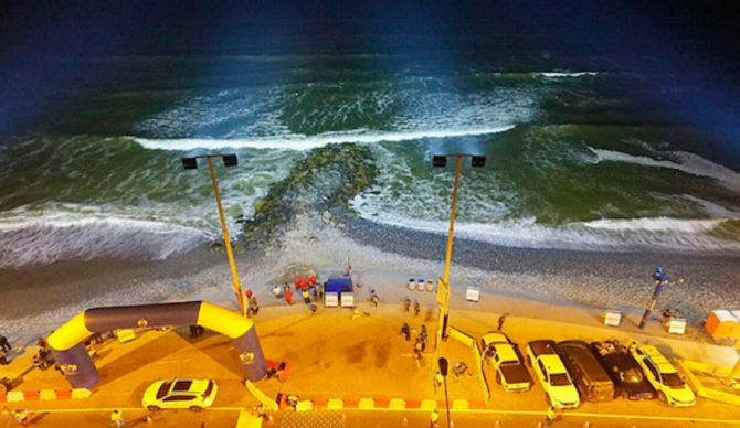 1,000 watt LED lights atop four 59ft posts now illuminate a stretch of beach in Lima, Peru. The hope is to extend beach activities past daylight hours, specifically surfing. Photo: Radio Capital