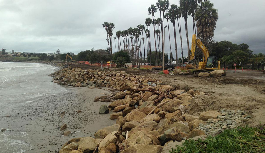 Installing large boulders as rip rap to armor the shore against further erosion at Goleta Beach in Southern California. The tide is very low (negative). Daniel Hoover/U.S. Geological Survey