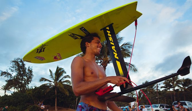 Kai Lenny with his hydrofoil surfboard. Photo: Casey Acaster