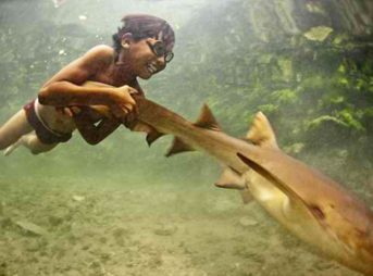 A Bajau child looking just at home under water as above. Image: BBC/Filipinow