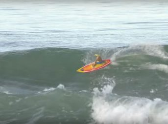 Larry Howlett figured out how to actually surf the way he wants to mind surf. What's he riding? A custom Maui RC Surfer called In Da Tube.
