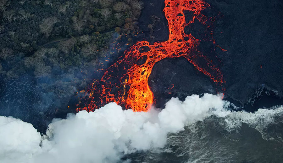 An aerial view of a massive surface flow entering the sea at Malama Flats Hawai'i. Image EPA  Bruce Omori  Paradise Helicopters