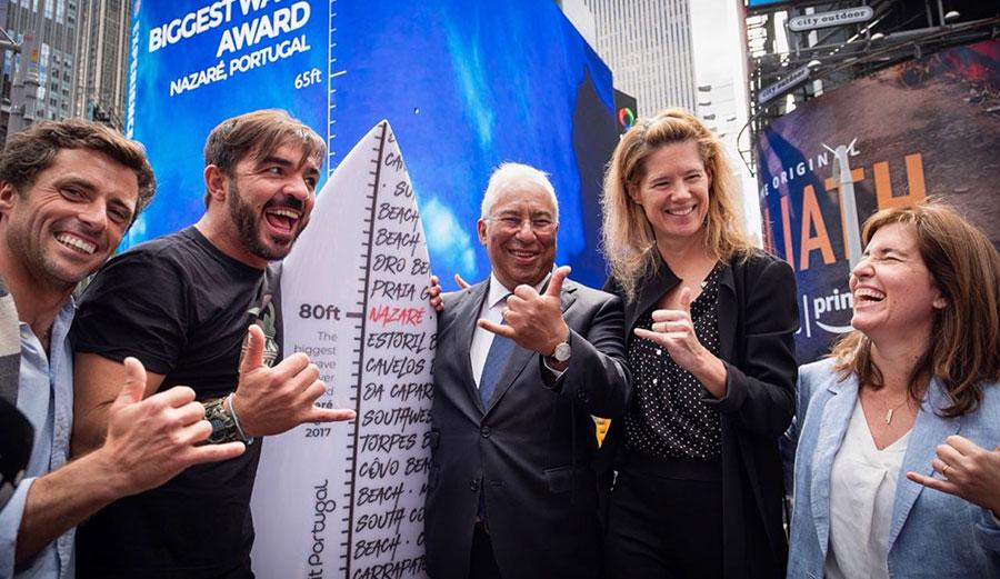 Ski driver Sérgio Cosme, Rodrigo Koxa, Prime Minister António Costa, WSL CEO Sophie Goldschmidt, and some very awkward-looking shakas.