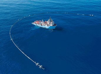 "The Ocean Cleanup Project's System 001 is currently floating in the Pacific corralling plastic in the ""largest ocean cleanup effort ever."" Photo: The Ocean Cleanup"