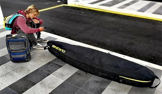 surfboard bag, dakine, surf travel, baggage fees, flipboard
