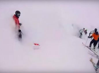 An avalanche rushes down through a resort, burying skiers in its wake.