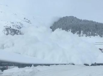 Man sitting in car in Davos, Switzerland gets buried by avalanche.
