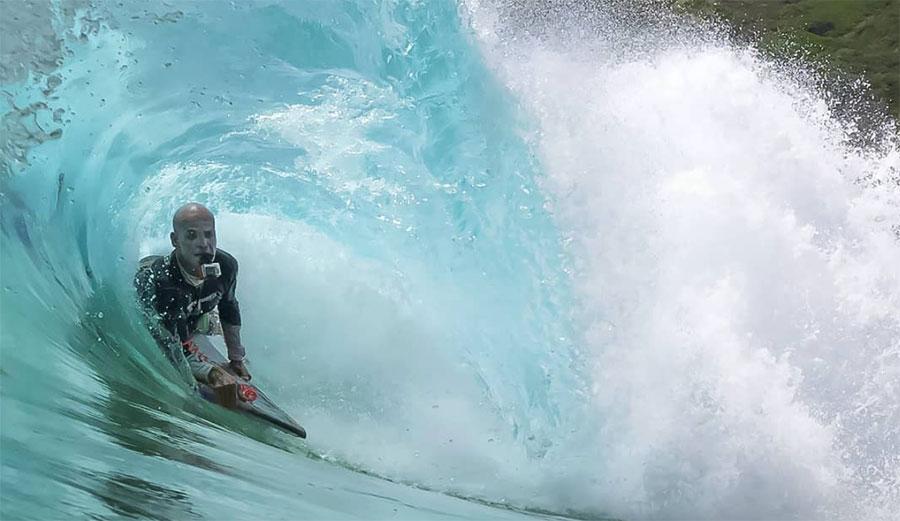 Marcus Biju surfing