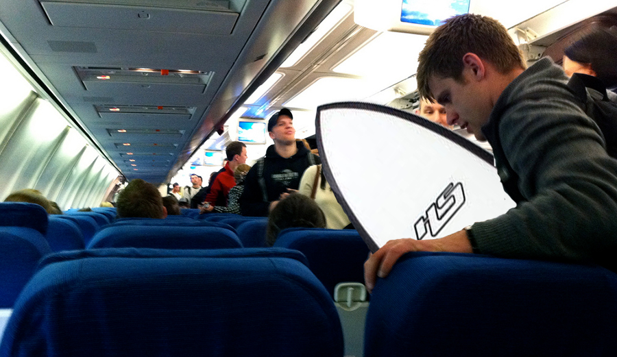 Photoshopped traveler with surfboard