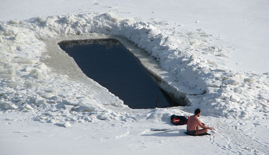 Man swimming in cold water