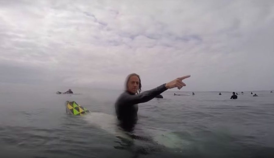Guy pointing surf lineup