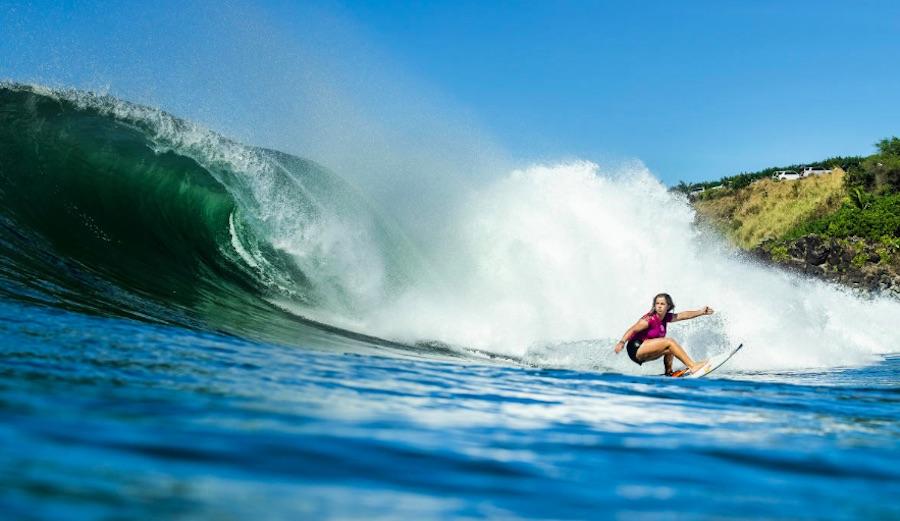 Caroline Marks bottom turning at Honolua Bay in Maui.