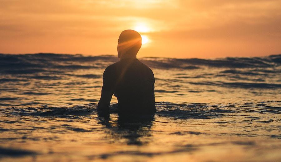 Man waiting for wave. Dawn patrol.