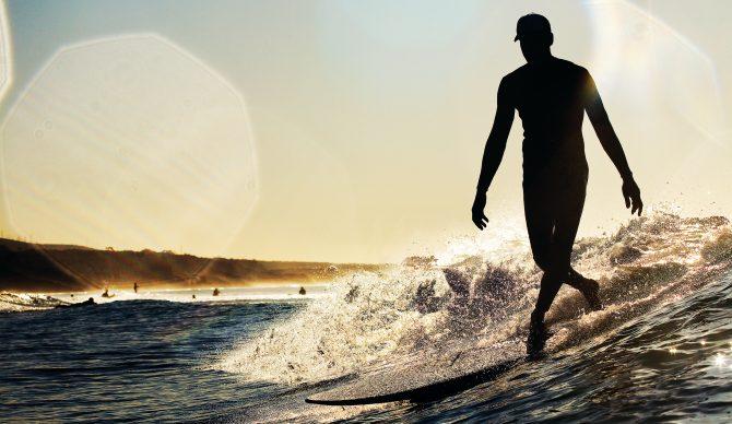 Longboard surfer in California