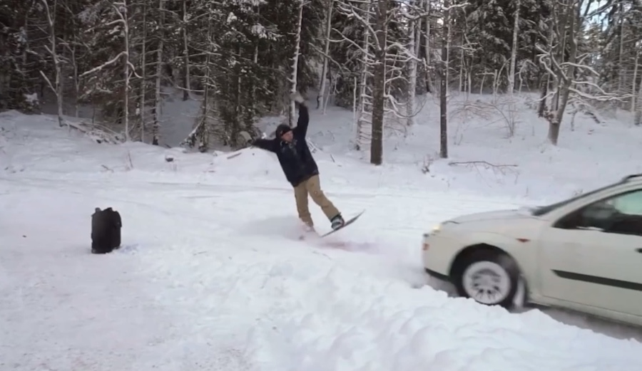 How's This Snowboarder's Backflip Off a Moving Car?