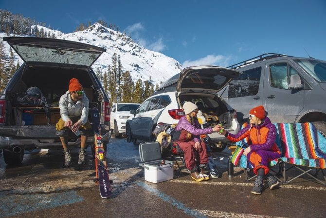 McKenna Peterson, Sam Cohen, Amie Engerbretson  enjoying some apre ski beers in the parking lot of Alpine Meadows. Photo: IKON Pass.